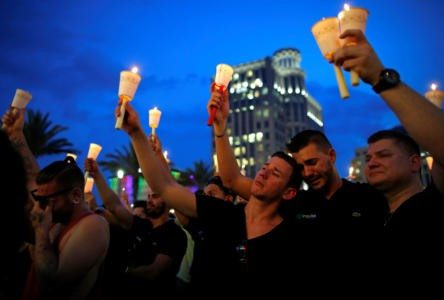 People gather for a candlelight vigil during a memorial service for the victims of the shooting at the Pulse gay nightclub in Orlando, Florida, June 13, 2016. REUTERS/Jim Young (Newscom TagID: rtrlseven931942.jpg) [Photo via Newscom]