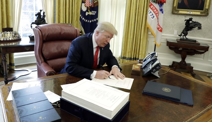 Trump signs spending bill ending shutdown, governmentwill reopen Tuesday