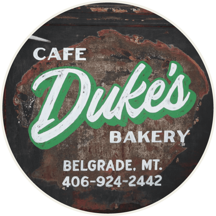 Duke's Cafe and Bakery welcome sign in Belgrade, Montana