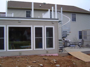 Addition with deck and hot tub