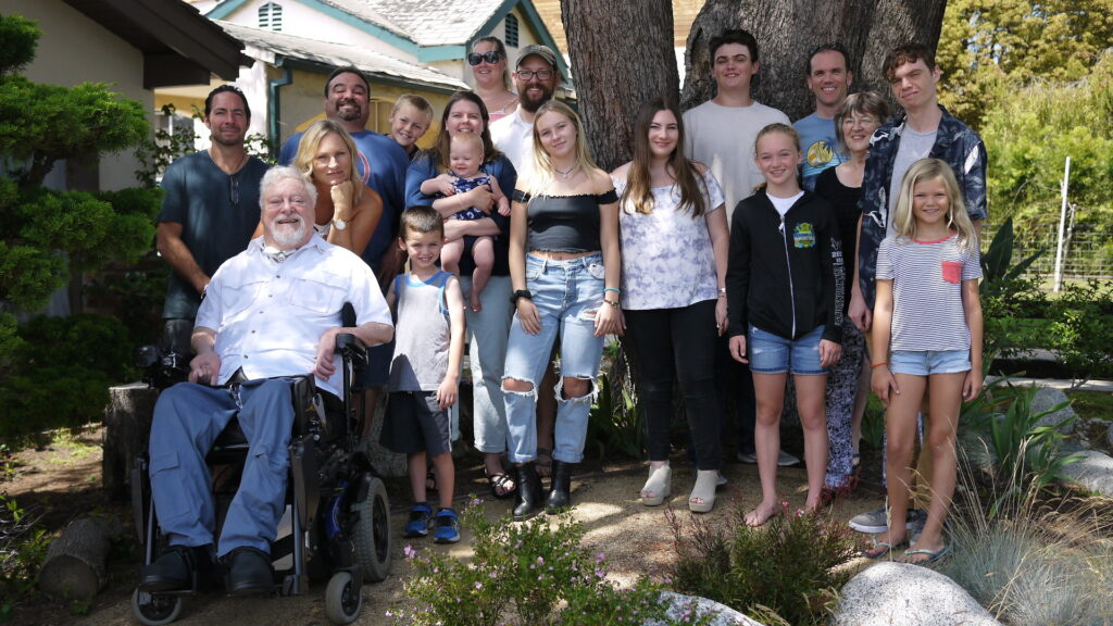 Gale Williams is sitting in his wheelchair, surrounded by his beautiful family in the garden of his home in Santa Monica
