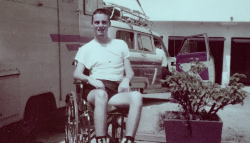 Gale Williams in his wheelchair, age 27.