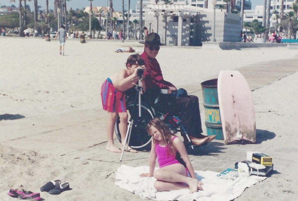 Gale and his two children are at the beach in Santa Monica