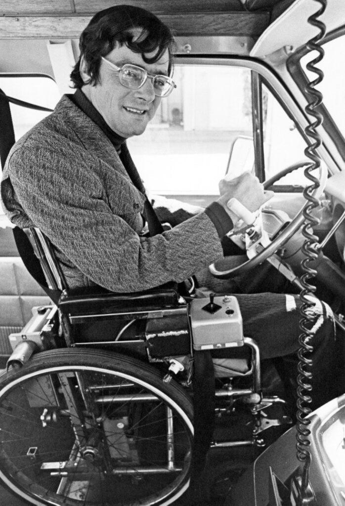 Gale in his wheelchair, driving his van