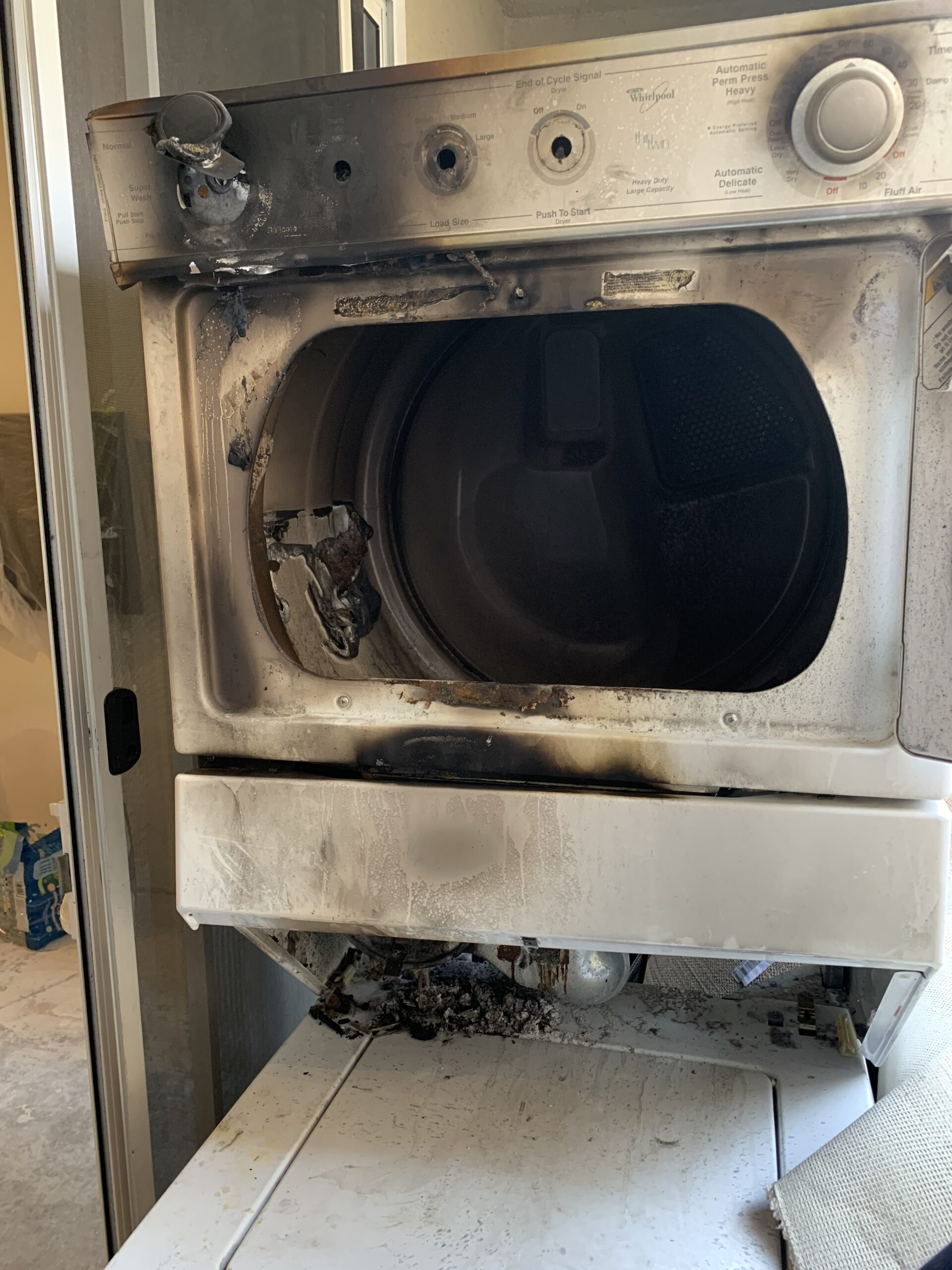 Burnt Dryer caused by the lint trap getting clogged and catching fire