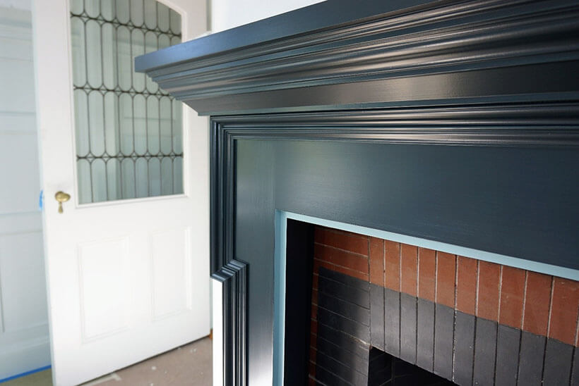 blue fireplace mantel in formal dining room