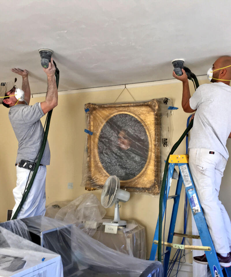 Newton painters working on ceiling
