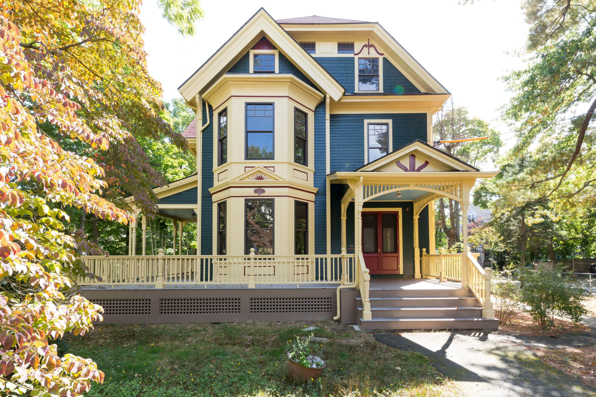 Full image with an exterior front view of the historic Victorian home