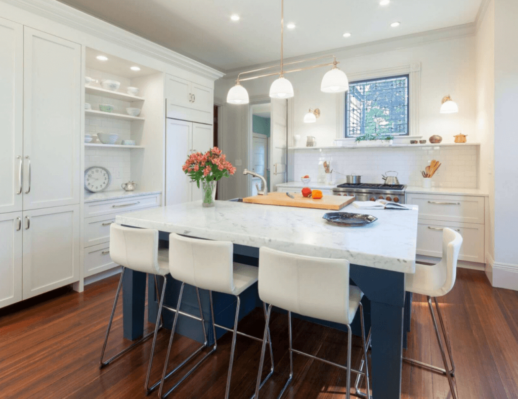 historic color scheme with blue kitchen island in an old kitchen