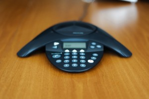 Conference business phone on a wooden meeting room