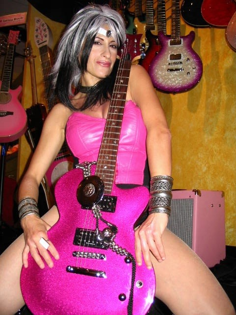 LYNN JULIAN as CCG POP SUPERHERO for photo shoot at Daisy Rock Guitars in Los Angeles, CA