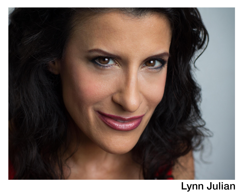 Lynn Julian, Boston Actress, Film Headshot with evil grin.