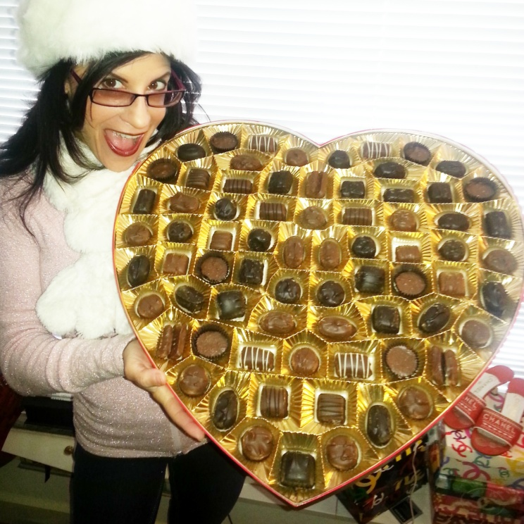 Lynn Julian, Boston Actress, with a HUGE, heart shaped box of chocolates for Valentine's Day.