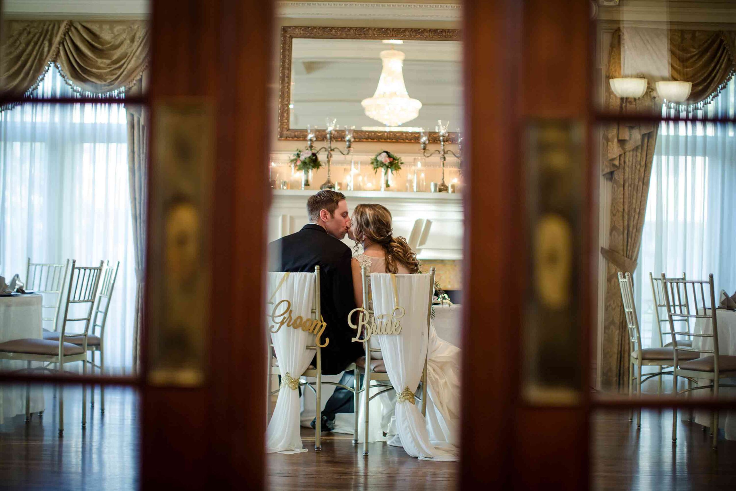 bride and groom kissing loose mansion kc