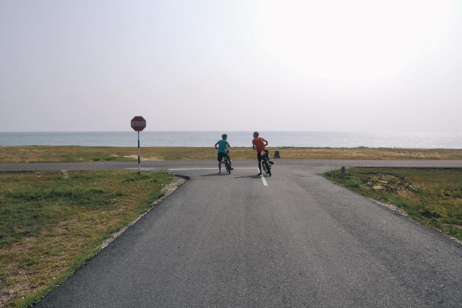 Two cyclist stopped at the T-junction