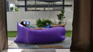 Man relaxing on the air sofa