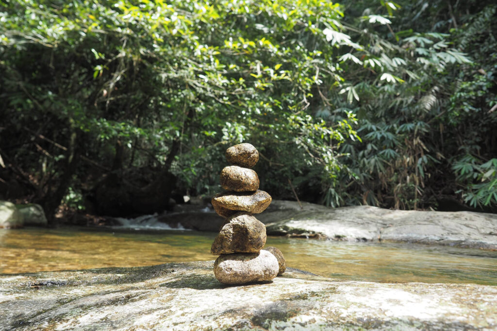 Rocks stacking in from of a river