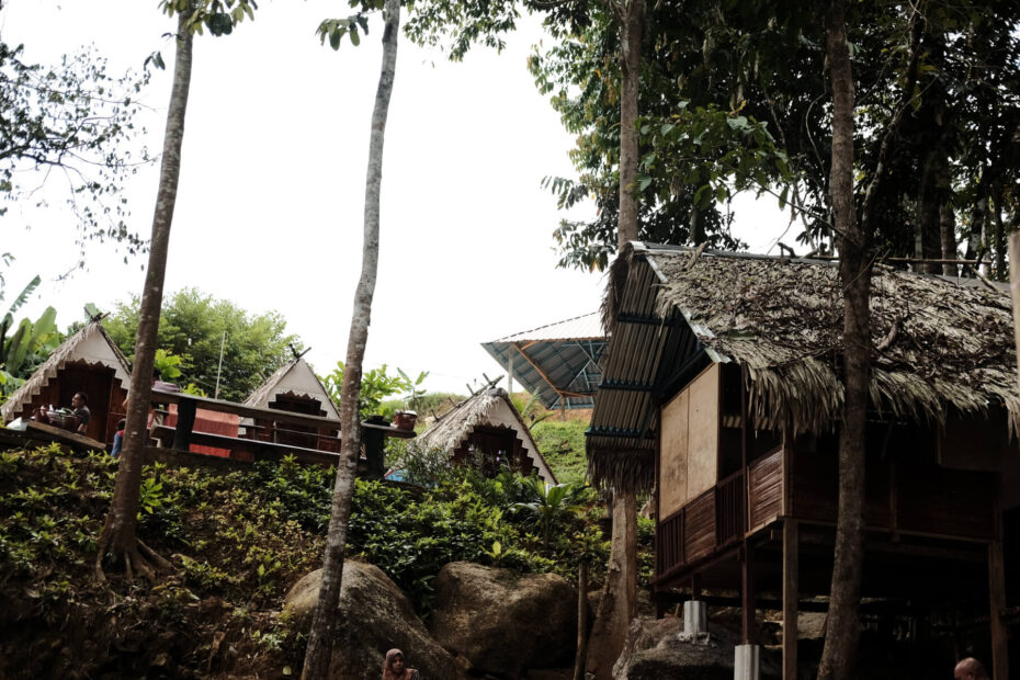 A few wooden chalets on the steep slope