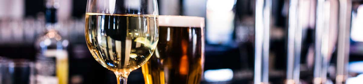 Glass of white wine on the bar