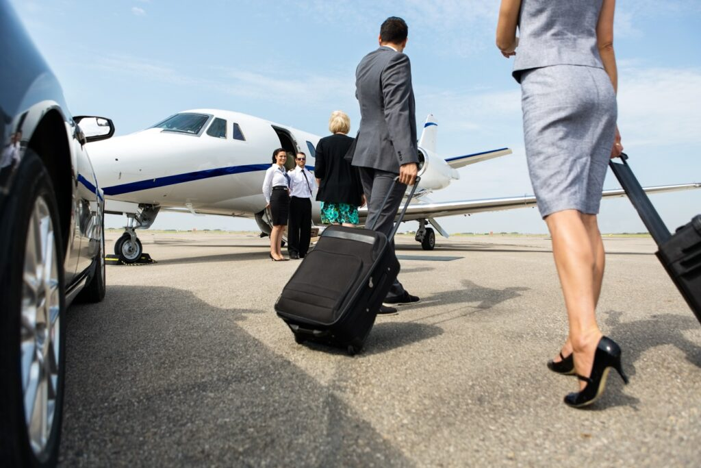 private jet travel and covid - business people boarding a private jet