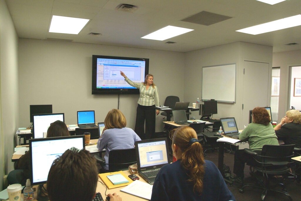 classroom with students and instructor learning business