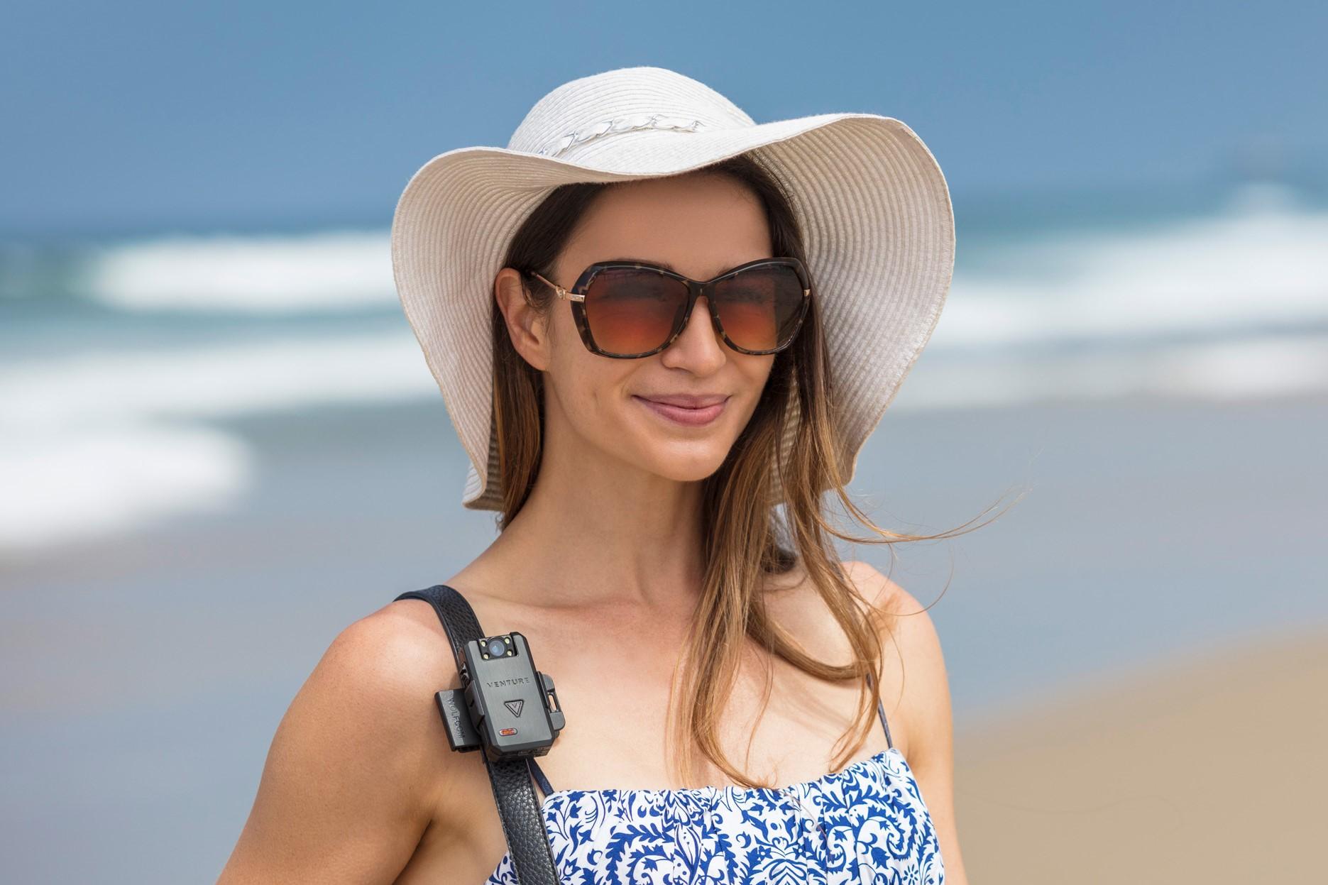 Venture bodycam clipped on a woman's purse