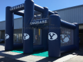 dual kick and toss custom interactive inflatable football game for byu