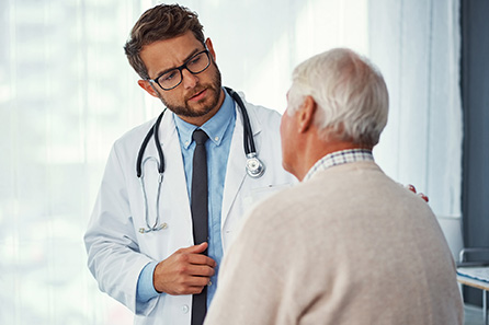 primary care physicians meeting with elderly man