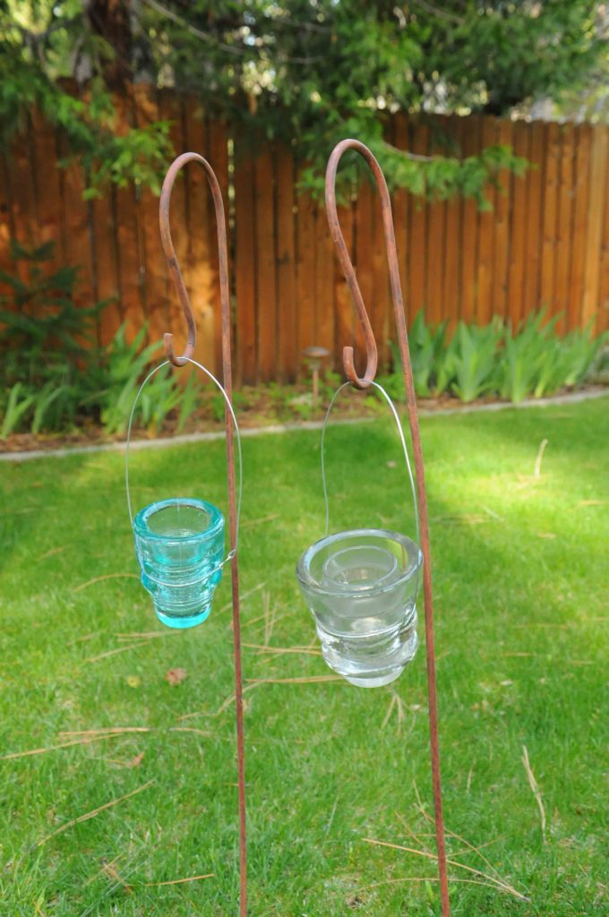Shepherd hook $5, Hanging glass insulators $3