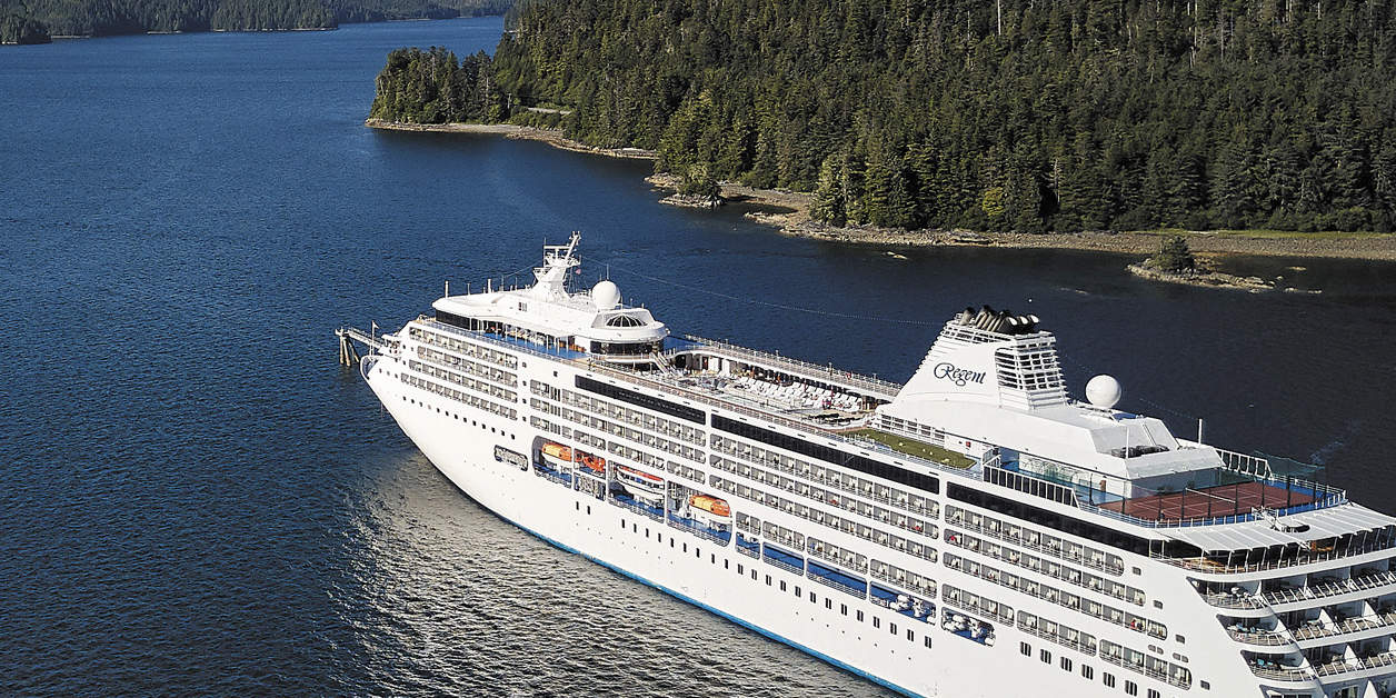 Aerial view of Regent ship sailing between mountains