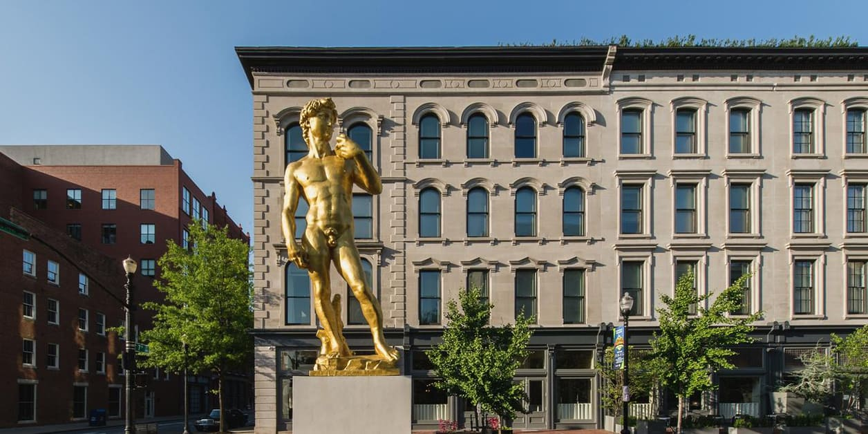 21c hotel Louisville exterior view of hotel and golden statue of David