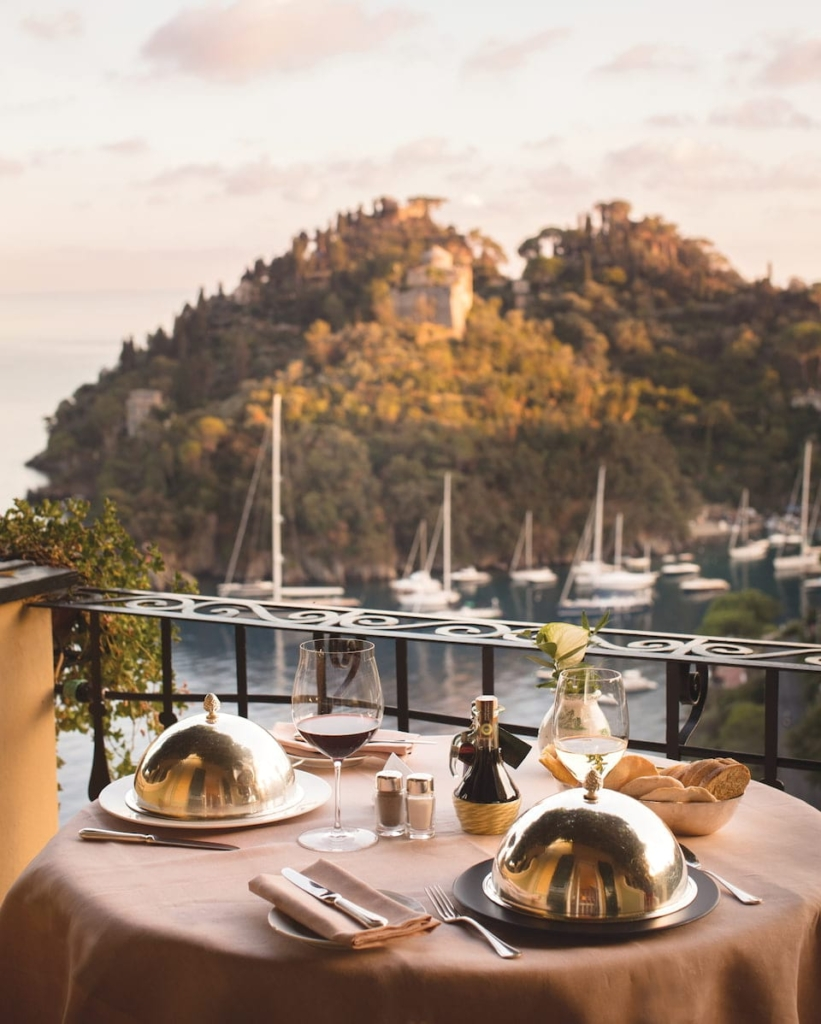 Belmond Splendido private dining setup with boats in background