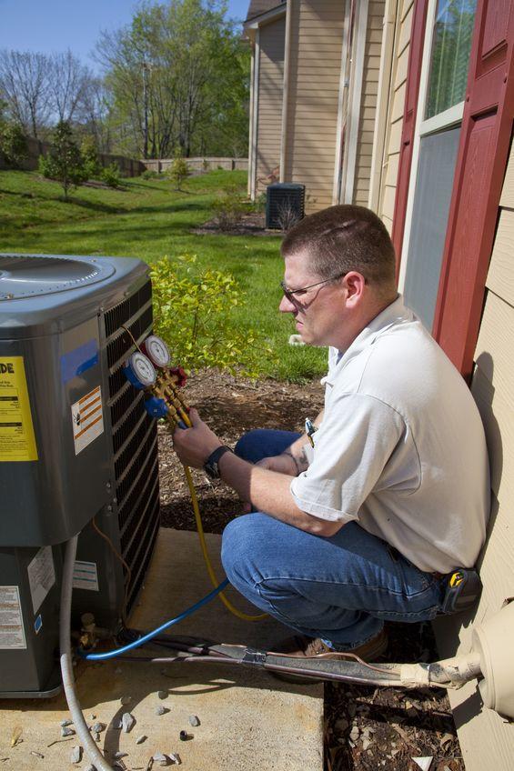 technician installing ac unit