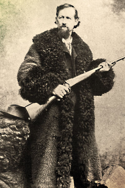 """A contributor to the slaughter, Charles """"Buffalo"""" Jones wears a buffalo coat, a heavy and super warm overcoat mainly worn on the frontier by stagecoach drivers and other folks who had to sit in the cold for extended periods. – True West Archives –: http://www.truewestmagazine.com/the-buffalo-hunters-war/"""