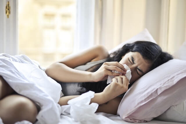 sick woman in bed before cellular therapy