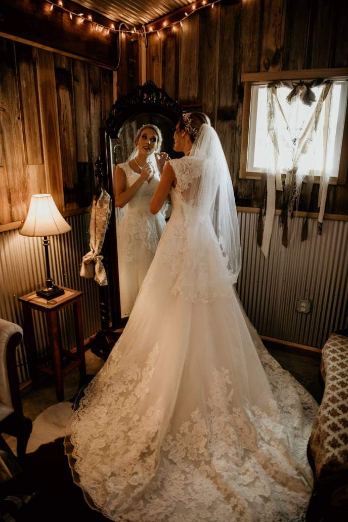 Wedding bride doing makeup in front of a mirror