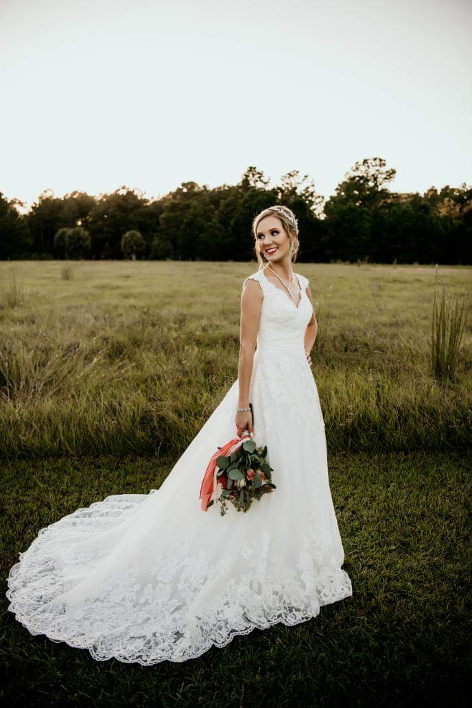 Wedding bride looking to the left while holding a flower bouquet