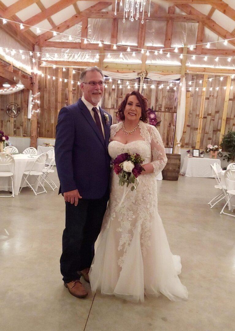 Wedded couple inside the barn