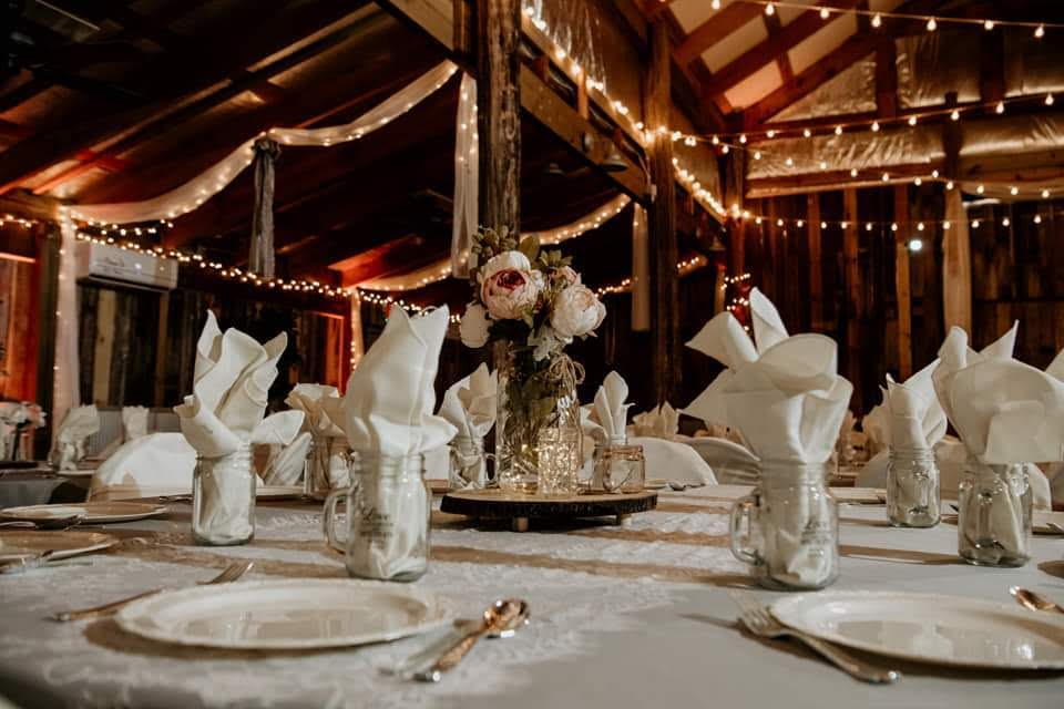 White-themed reception table with white flower centerpiece