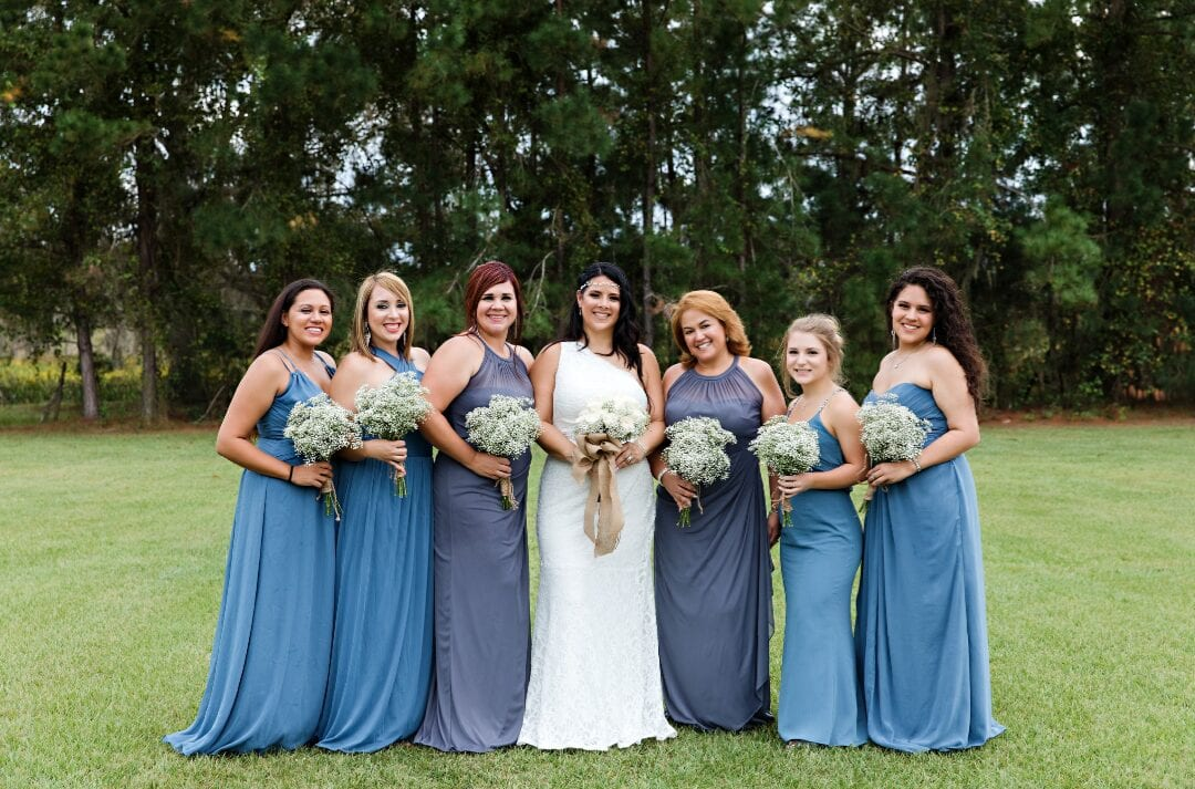 Bride with her bridesmaids in blue