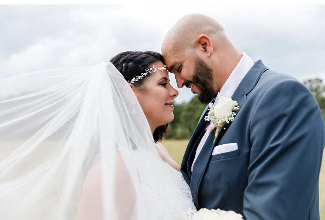 Wedding couple looking intimately at each other