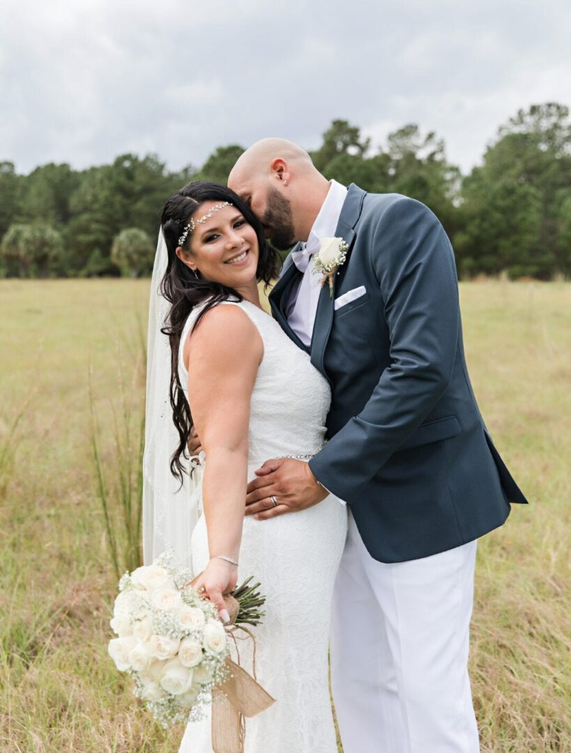 Groom kissing his bride on the cheek
