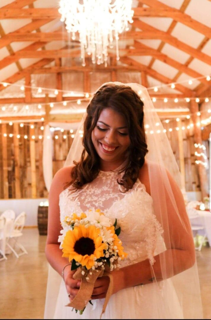 Wedding bride looking at her sunflower bouquet