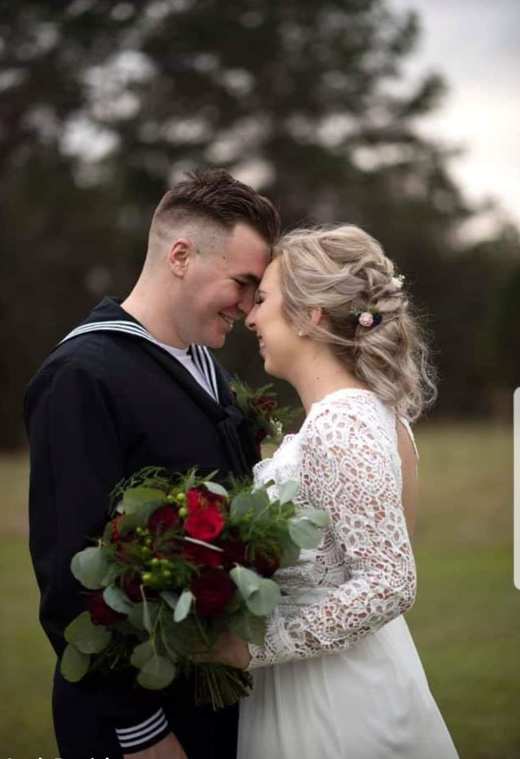 Wedding couple drawing their heads closer while smiling
