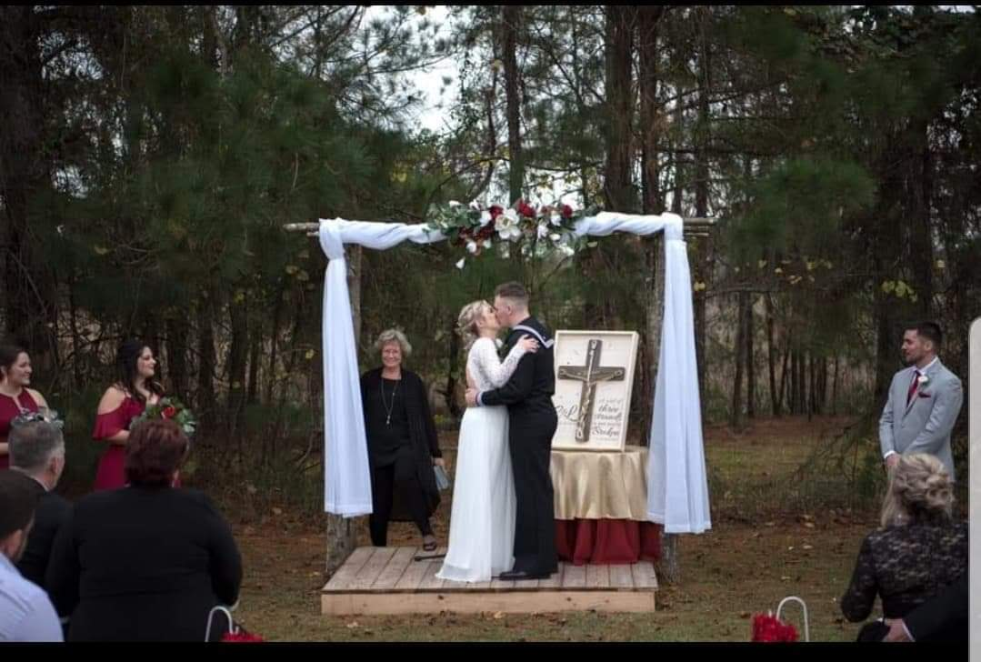 Wedded couple kissing in front of the crowd