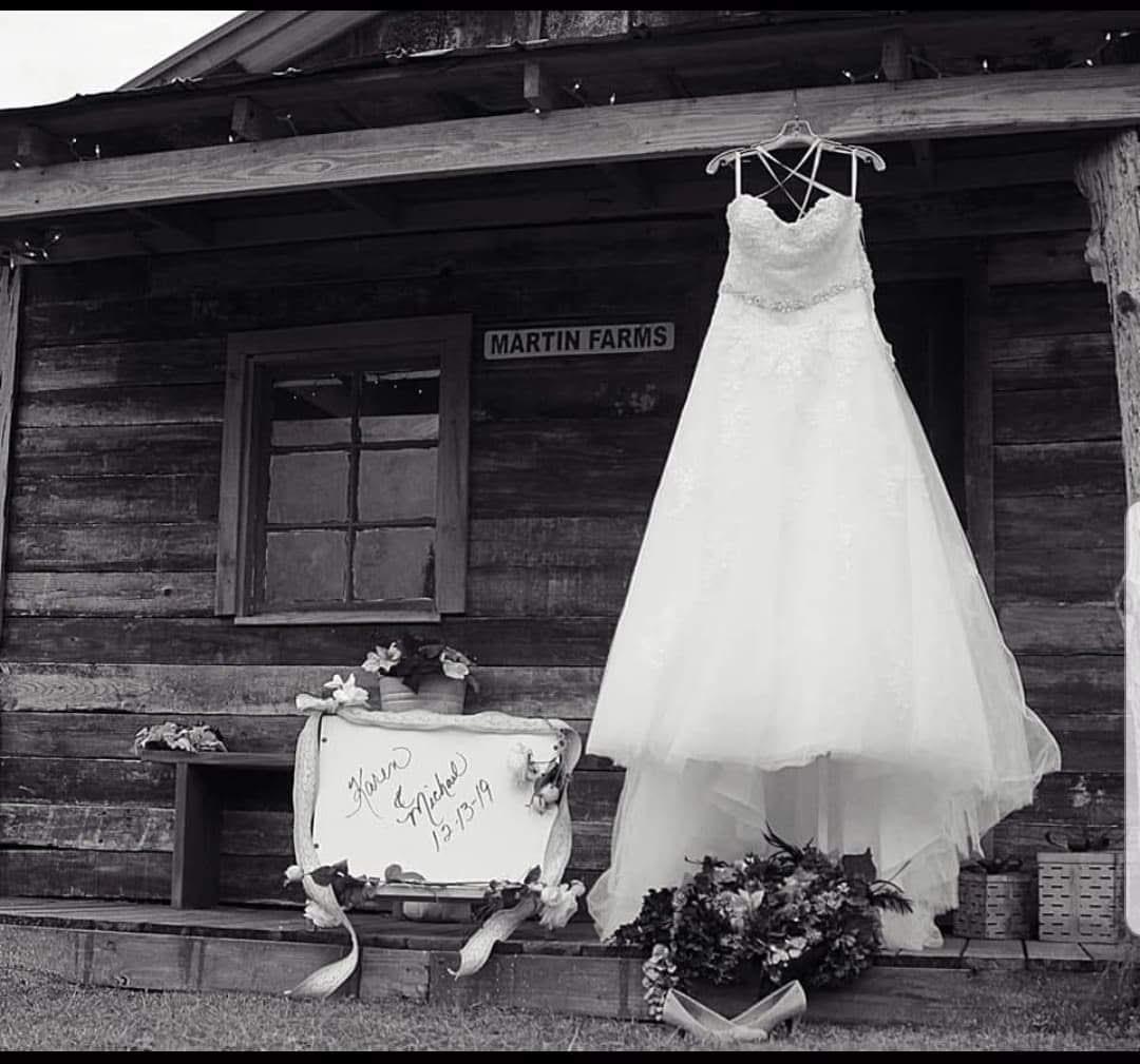 Karen and Michael's wedding with a wedding dress hanged