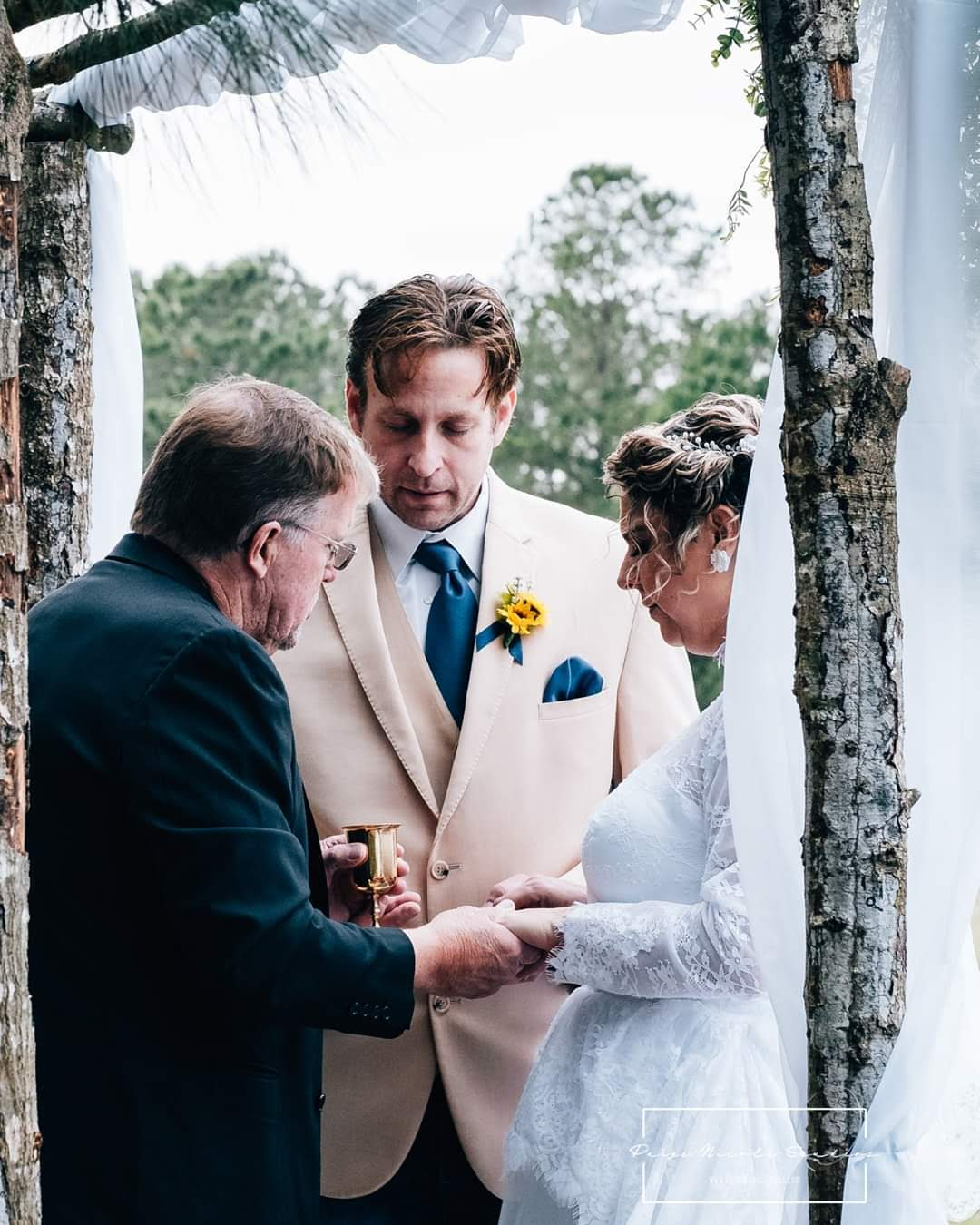 Wedding couple exchanging vows in front of a minister