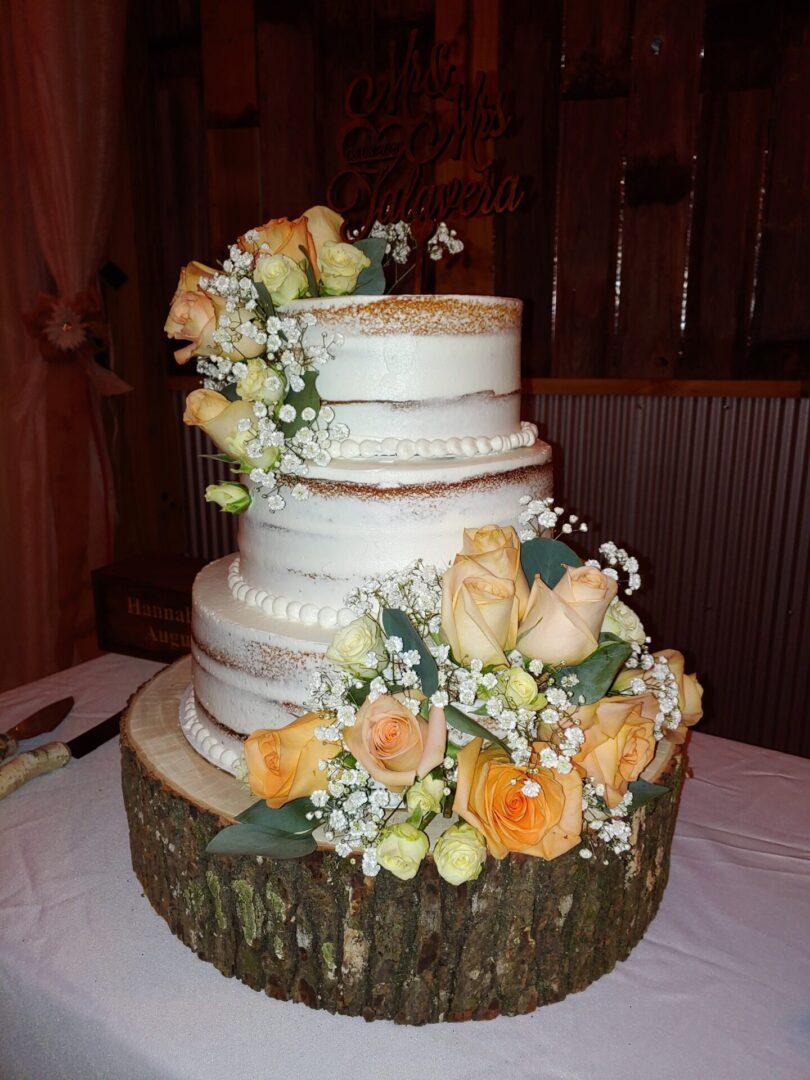 Three-tiered wedding cake with orange flowers