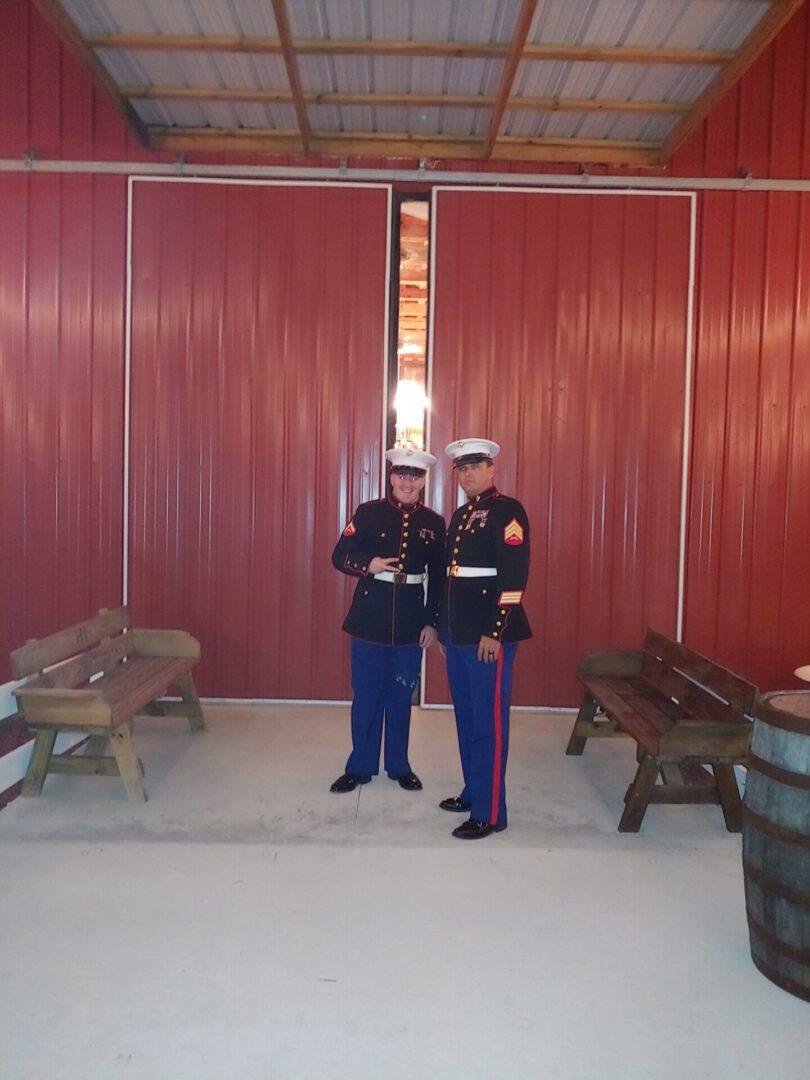 A pair of men wearing military regalia