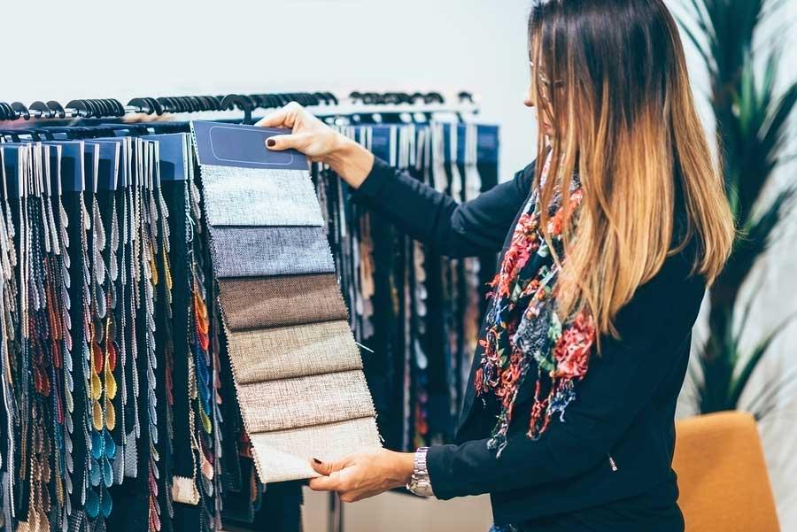 Interior Designer Looking at Fabric